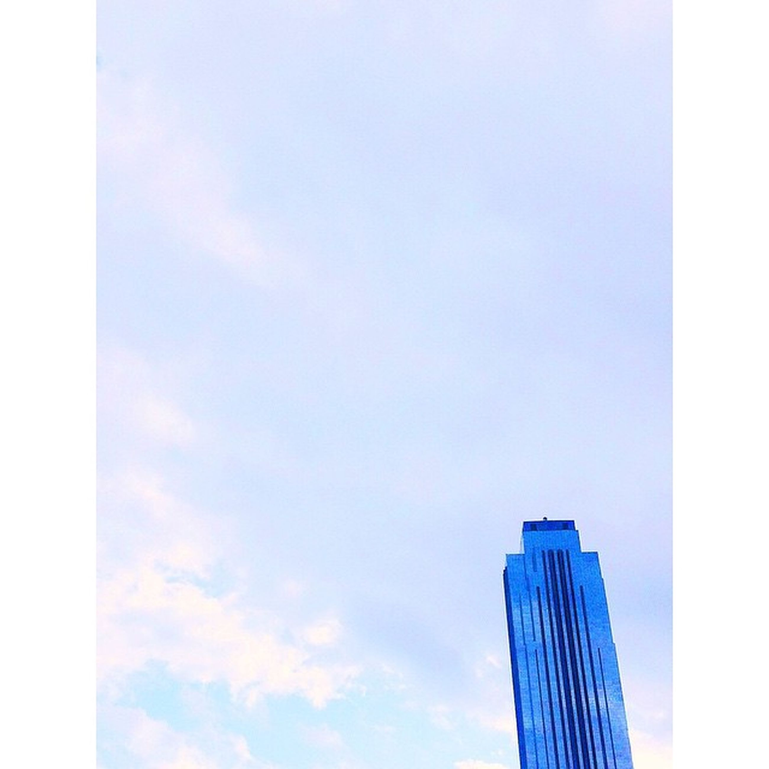 low angle view, transfer print, sky, auto post production filter, blue, built structure, architecture, building exterior, copy space, high section, outdoors, day, no people, cloud - sky, cloud, modern, nature, clear sky, pattern, tall - high