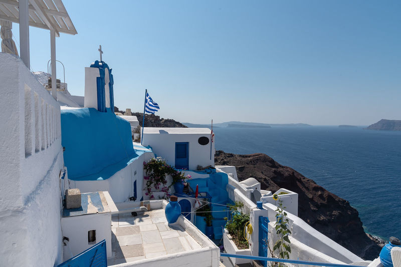 View of Oia - Santorini Cyclades Island - Aegean sea - Greece Greece Santorini Oia Island Maditerranean Sea Volcano Caldera Aegean Cyclades Architecture Built Structure Building Exterior Building Religion Belief Spirituality Water Place Of Worship Blue Nature Mountain Whitewashed White Color Outdoors