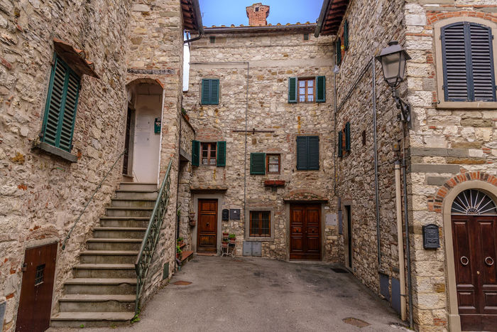 Streets of the famous town of Radda in Chianti, located in the heart of Chianti wine area Alley Architecture Brick Building Building Exterior Built Structure City Day Door Exterior House Italy Medieval No People Outdoors Residential Building Steps Stone Streets Tuscany Typical Urban Wall Window