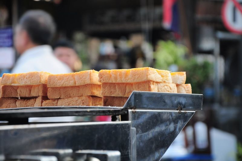 Close-up of bread slices on equipment