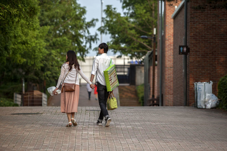 Casual Clothing City City Life Couple Dating Day Focus On Foreground Footpath Full Length Hand In Hand Leisure Activity Lifestyles Man And Woman Outdoors Seonyudo The Way Forward Tree Walking