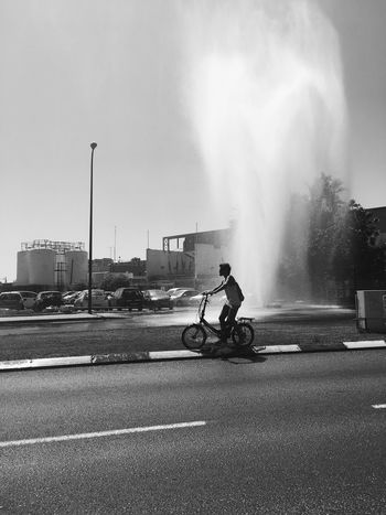 Incident Water Leak Transportation Land Vehicle Motorcycle Mode Of Transport Real People Built Structure Men Road Building Exterior Riding Sky Architecture One Person Outdoors Day Biker Street Broken Palm Tree Leakage Passing By People