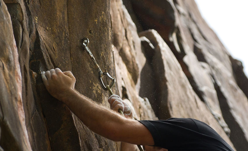 Rock Climbing Adult Arm Gripping Human Body Part Human Hand Leisure Activity One Person Rock Climbing Rocks Rope