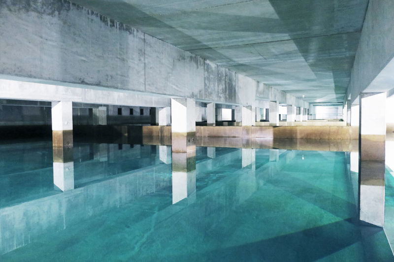 Turquoise Colored Underground Urbanism Water Reflections Architecture Blue Clean Clear Water Concrete Drinkable Water Groundwater Indoors  Infrastructure No People Parking Reflection Storage Storage Tank Swimming Pool Turquoise Water Underneath Water Water_collection Watertank Watertreatment
