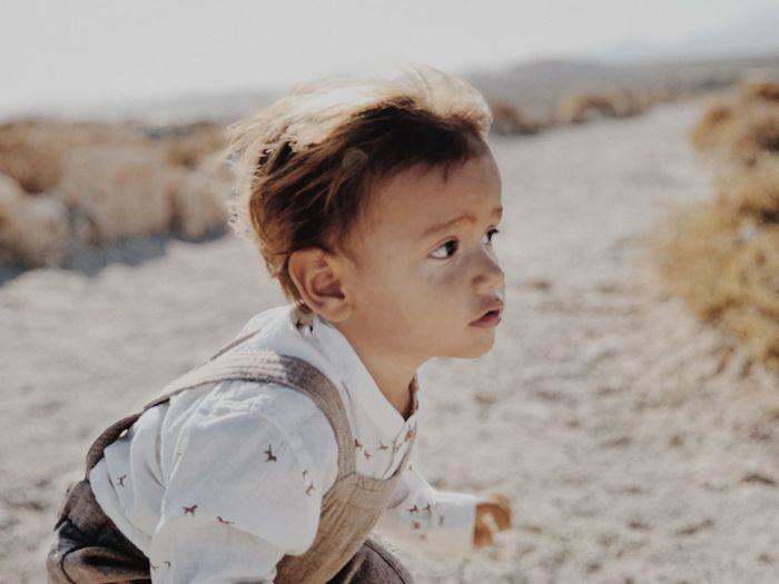 Portrait of boy looking away at beach