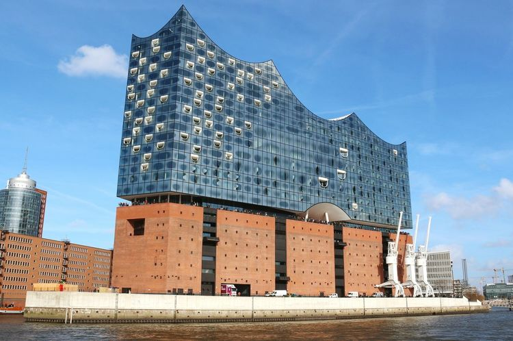 EyeEm Selects Architecture Sky Business Finance And Industry Modern Built Structure Building Exterior Skyscraper Outdoors Water Day Elbphilharmonie Music Windows Architecture_collection People Watching Blue Sky Waterviews