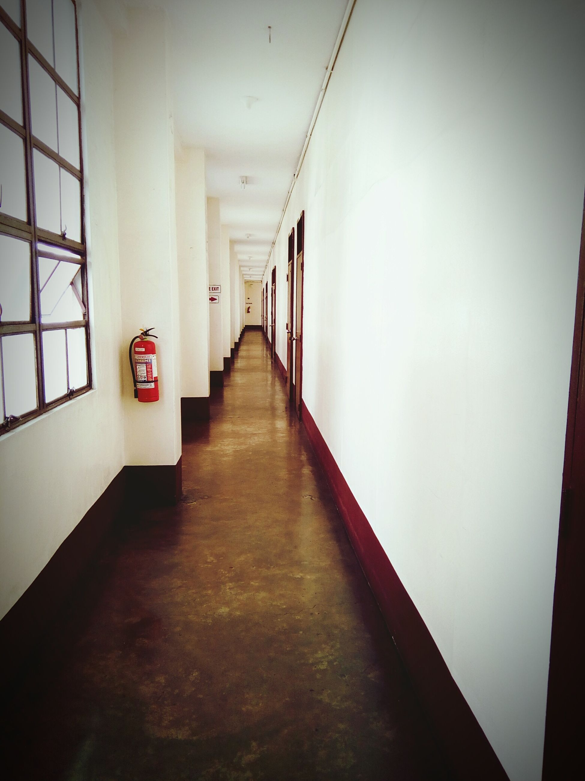 indoors, modern, flooring, diminishing perspective, corridor, empty, wall - building feature, hardwood floor, the way forward, vanishing point, surface level, narrow, pink color, no people, long
