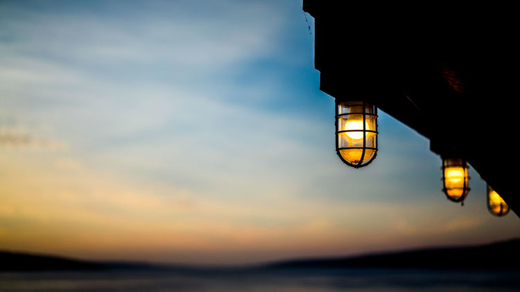 End of a day Beauty In Nature Illuminated Lighting Equipment Low Angle View Nature Night No People Outdoors Scenics Sea Sky Sunset Water