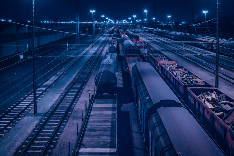 High angle view of freight train at night