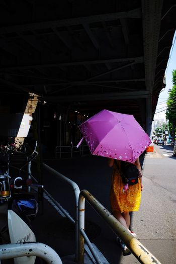 Light And Shadow Under The Bridge Sunlight Umbrella Real People Built Structure Street