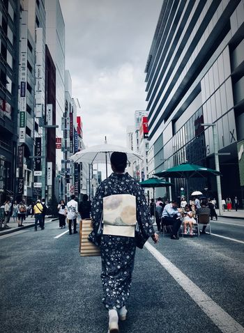 Girl with kimono in Ginza Girl With Umbrella Kimono Girl KimonoStyle Kimono Cloudy Sky ShotOnIphone Tokyo Streetphotography Japan Photography Tokyo Street Photography Japan City Street Building Exterior Architecture Transportation Built Structure Motor Vehicle Sky Real People Road City Life Rear View City Street Lifestyles Day The Street Photographer - 2018 EyeEm Awards