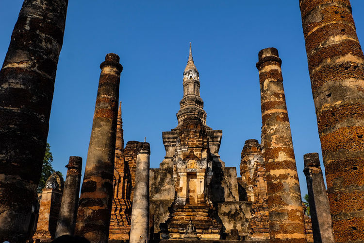 Mahathat Temple in Sukhothai Religion Architecture Architectural Feature History Business Finance And Industry Travel Destinations Ancient Civilization Spirituality Old Ruin Statue Built Structure Human Body Part Building Exterior City Day People Sukhothai Thailand🇹🇭 Sukhothai Art Cloud - Sky Ancient History Ancient Travel Spirituality Cultures
