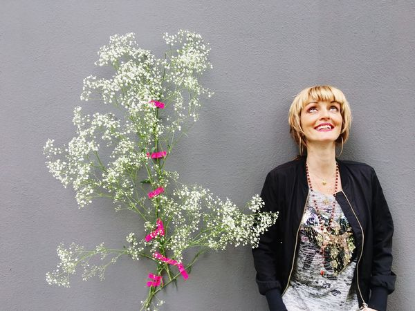 Su with her beautiful smile, the white flowers and the pink tape Only Women One Woman Only Adults Only Adult Gray Background Flower One Person Portrait People Front View Studio Shot Women Beautiful Woman One Mature Woman Only Blond Hair Happiness Smiling Indoors  Business Beauty Grey Wall Makeportraits IPhoneography Portrait Of A Woman Goodfeelography