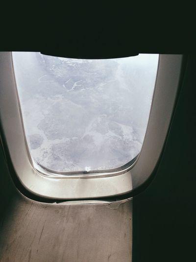 View of landscape seen through train window