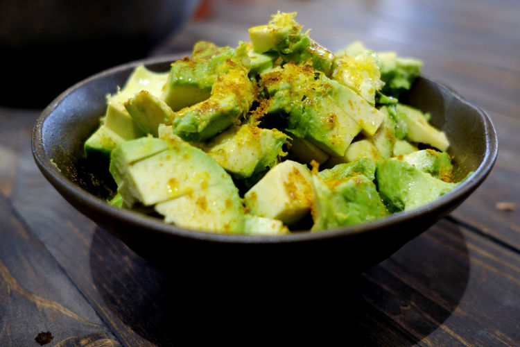 A food bowl, filled with avocados. Vegetarian Food Avocado Bowl Bowls Close-up Day Focus On Foreground Food Food And Drink Food Bowl Freshness Green Color Healthy Eating High Angle View Indoors  No People Ready-to-eat Table Vegetable Vegetables
