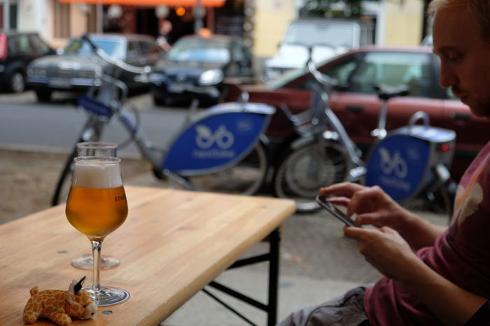This July I had a visitor over the weekend. We decided to try out the NextBike app to move around. In just few minutes we traveled from Neukölln all the way to the Straßenbräu brewery in Friedrichschein and enjoyed a pint there // Real People Focus On Foreground Craft Beer Holding One Person Outdoors Lifestyles Women Close-up Sitting Day Human Hand City People FUJIFILM X-T10 F/3.6 Iso 200 XF18-55mmF2.8-4 R LM OIS via Fotofall