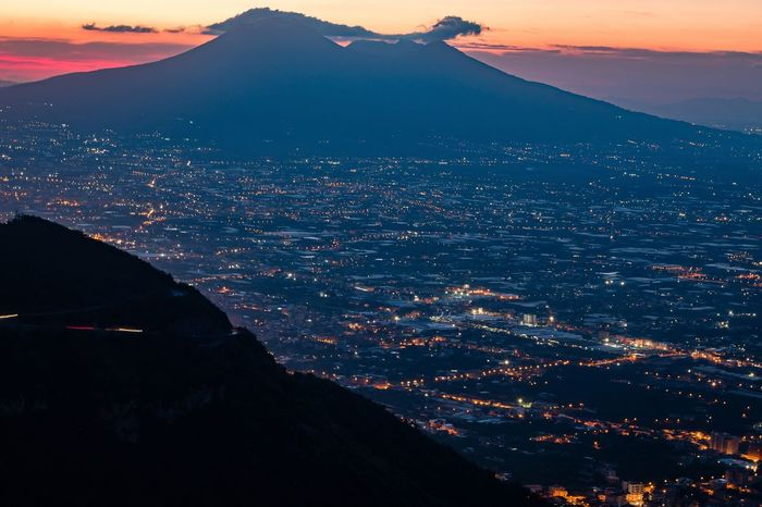A view of Mount Vesuvius and the Gulf of Naples from the car park on the road to Corbara Aerial View Beauty In Nature City Cityscape Dusk Landscape Mountain Mountain Range Naples No People Outdoors Scenics Sunset Tranquility Travel Destinations Twilight Twilightscapes Vesuvio Volcano Volcano Landscape
