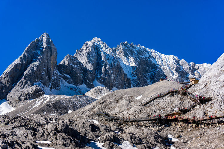 Jade Dragon Snow Mountain,Mount Yulong or Yulong Snow Mountain at Lijiang,Yunnan province,China. Beauty In Nature Blue Clear Sky Day Landscape Mountain Mountain Range Nature No People Outdoors Range Sky Snow Snowcapped Mountain