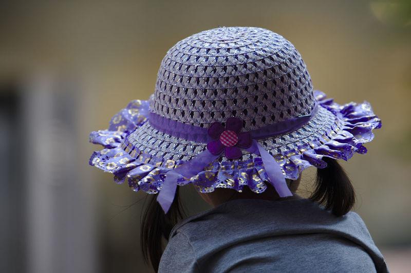 Rear view of girl wearing purple hat