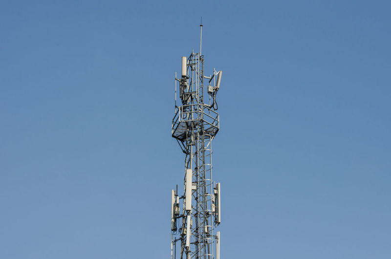 Telecommunication Tower. Cell Phone Signal Tower on sky background Can be used for display or montage your production. Presentation of advertising ideas. Electromagnetic Cell Phone Signal Tower Antenna Background Broadcasting Frequency Microwave Receiver Technology Telecommunication Tower Transmitter Wireless Technology