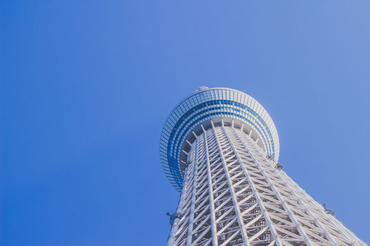 Low angle view of tokyo sky tree against clear blue sky