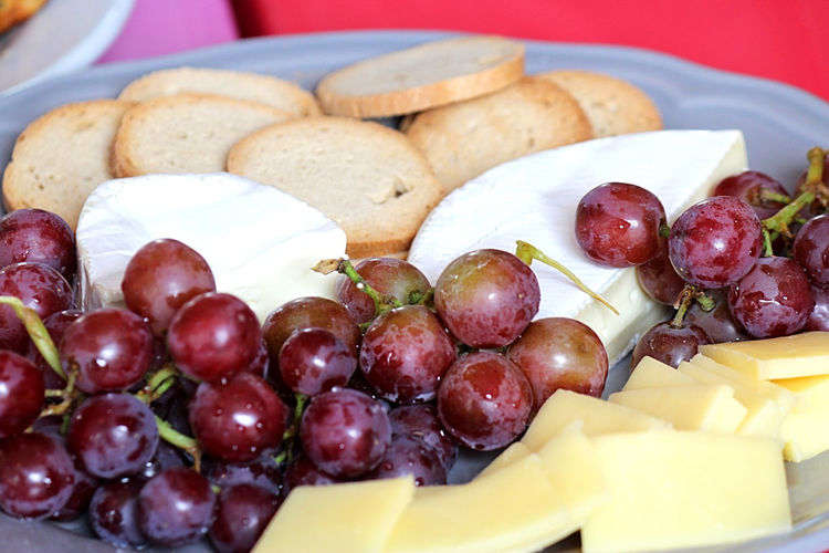 Platter of cheese food and crackers Cheese! Black Olive Cheeseplate Close-up Day Food Food And Drink Freshness Fruit Grape Healthy Eating Indoors  No People Plate Raisins Raisins With Fruit Raisinswithcheese