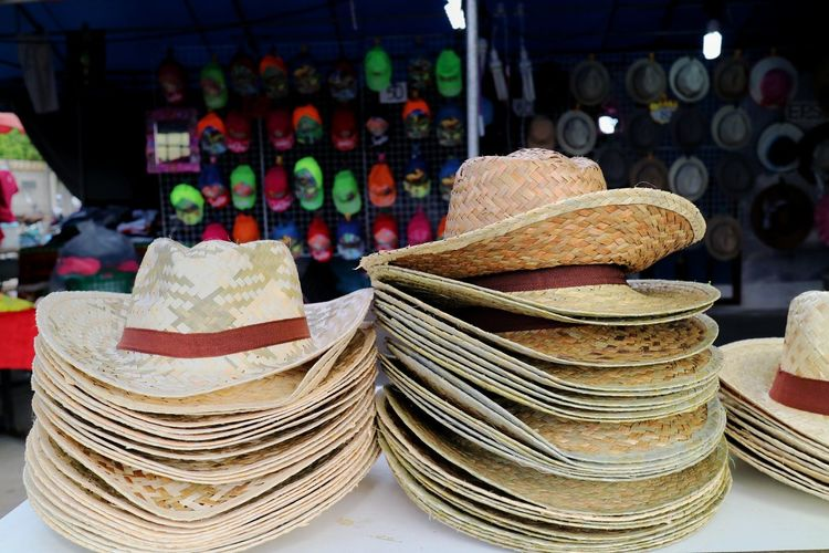 Stack of hats for sale in market