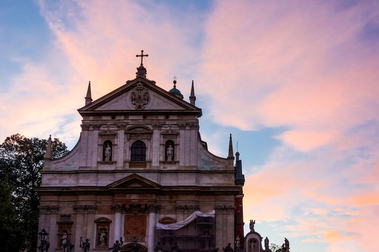 Low angle view of saints peter and paul church against cloudy sky during sunset