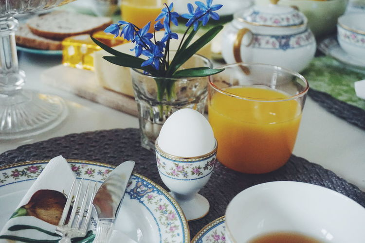 High Angle View Of Boiled Egg And Juice Served On Dining Table