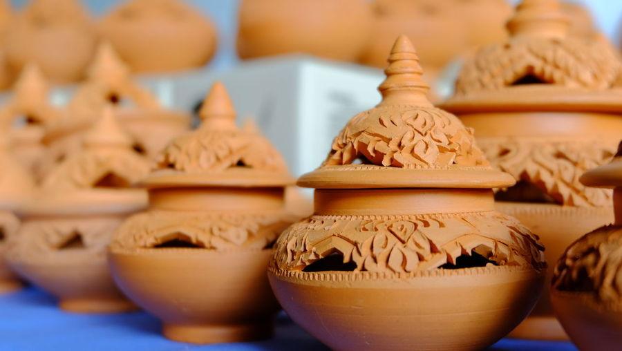 Close-up of various pots at market stall