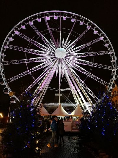 Arts Culture And Entertainment Night Illuminated Ferris Wheel Celebration Sky Low Angle View Amusement Park Ride Amusement Park No People Outdoors Chain Swing Ride Firework