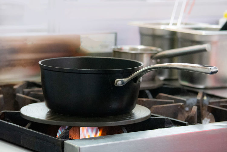 Kitchen Stove Domestic Room Heat - Temperature Household Equipment Domestic Kitchen Home Kitchen Utensil Appliance Burning Indoors  Burner - Stove Top No People Close-up Food And Drink Fire Focus On Foreground Flame Preparation  Pan Gas Stove Burner Steel Saucepan Crockery