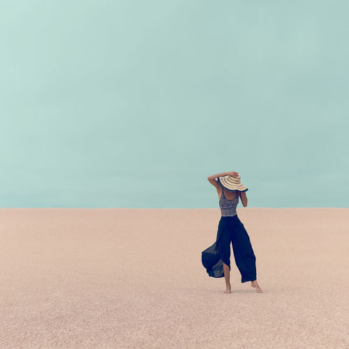 Fashion model in the desert on vacation