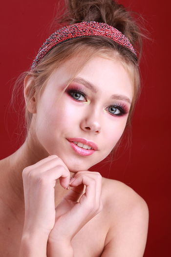 Headshot Portrait Studio Shot Red Studio Photography Teenager Teenage Girls Fashion Fashion Photography Fashion Model Beauty Cute Red Background Hair Accessories Makeup Women Make-up Adult Front View Lipstick Body Part Glamour Hand Human Face Hairstyle