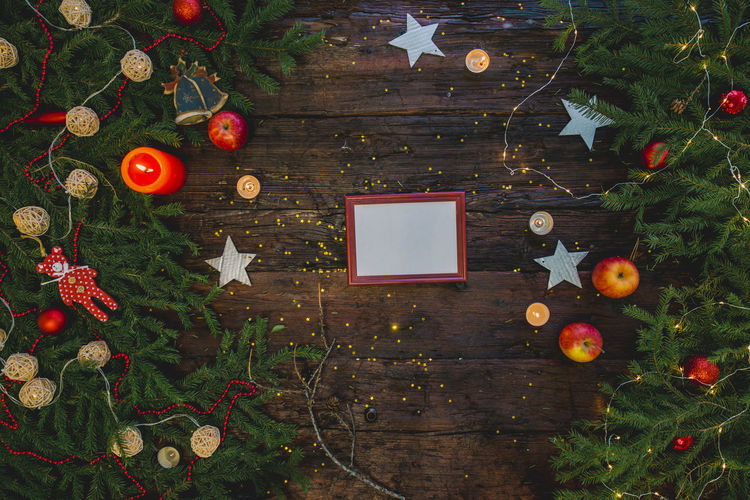 Blank frame on Christmas wooden table Celebration Holiday Decoration Christmas Christmas Decoration christmas tree Wood - Material Table Tree Christmas Ornament No People Directly Above Nature Indoors  Food Holiday Moments