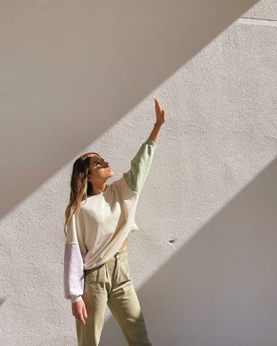 Woman standing against wall