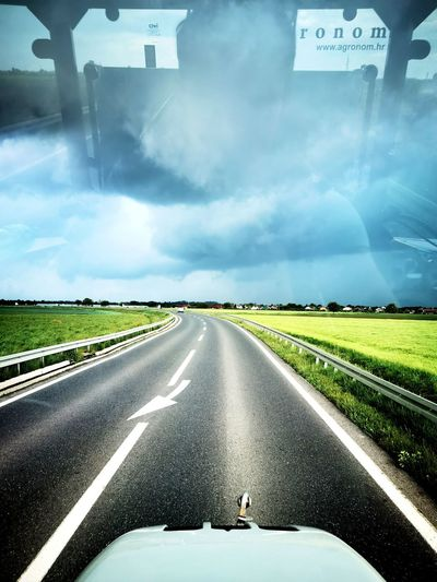 Road against sky seen from car windshield