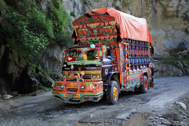Transportation Mode Of Transportation Land Vehicle Motion Nature Road Day Water Street Incidental People Outdoors Truck Motor Vehicle Travel People Architecture Real People Rickshaw