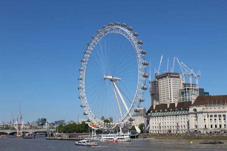 London London Eye Amusement Park Ride Architecture Built Structure City Clear Sky Day Ferris Wheel Nature Sky Travel Travel Destinations Water