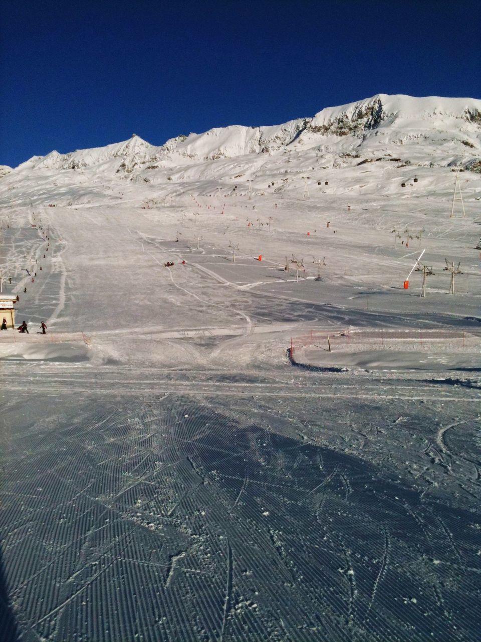 High Angle View Of Ski Lifts And Ski Track At Tourist Resort