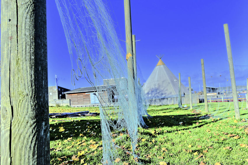 fishing nets Agriculture Architecture Blue Building Exterior Built Structure Day Drying Fishing Net Drying Net Drying Nets Fishing Net Fishing Nets Grass Landscape Nature Net Nets Nets Camp Nets Field No People Outdoors Rural Scene Sky