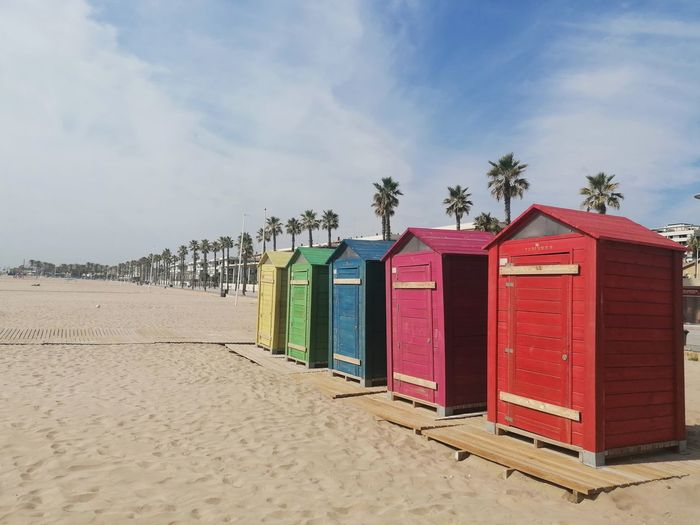 Beach huts against sky