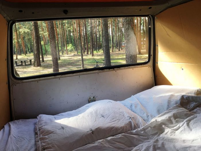 Bed in trailer home at forest
