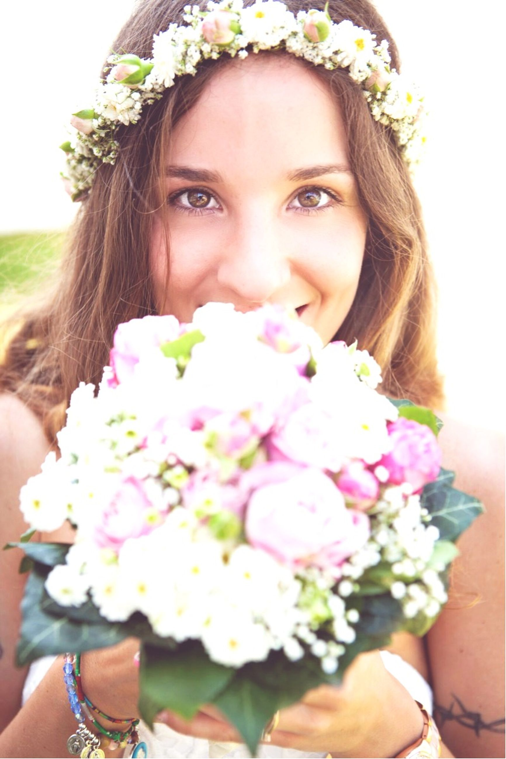 flower, young women, person, portrait, looking at camera, young adult, lifestyles, front view, freshness, leisure activity, smiling, fragility, long hair, casual clothing, close-up, headshot, focus on foreground