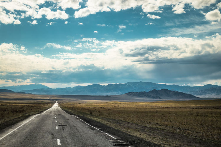 Mongolia Sky Cloud - Sky Direction Road Mountain Transportation The Way Forward Environment Landscape Beauty In Nature Scenics - Nature Non-urban Scene Diminishing Perspective Nature Day Mountain Range No People Tranquil Scene Sign Symbol Outdoors Long Dividing Line