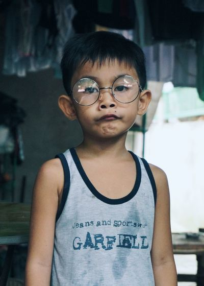 Childhood Child Portrait Eyeglasses  One Person Waist Up T-shirt Casual Clothing Looking At Camera Front View People Boy ASIA Philippines
