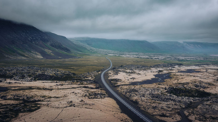 Aerial view of scenic driving road in iceland, moody atmosphere