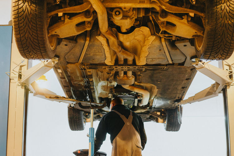 Under Car Repair Repair Shop Occupation Men Industry Car Industry Service Worker Auto Mechanic Mechanic Car Auto Repair Shop Service Factory Manufacturing Occupation