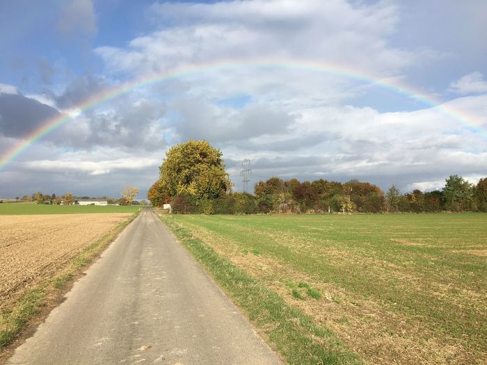 Beauty In Nature Cloud - Sky Day Double Rainbow Field Grass Green Color Growth Landscape Nature No People Outdoors Road Scenics Sky The Way Forward Tranquil Scene Tree