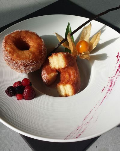 Close-up of donuts with berries served on plate